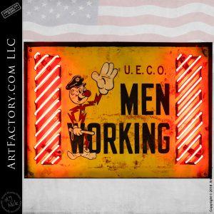 U.E.C.O. Men Working Sign